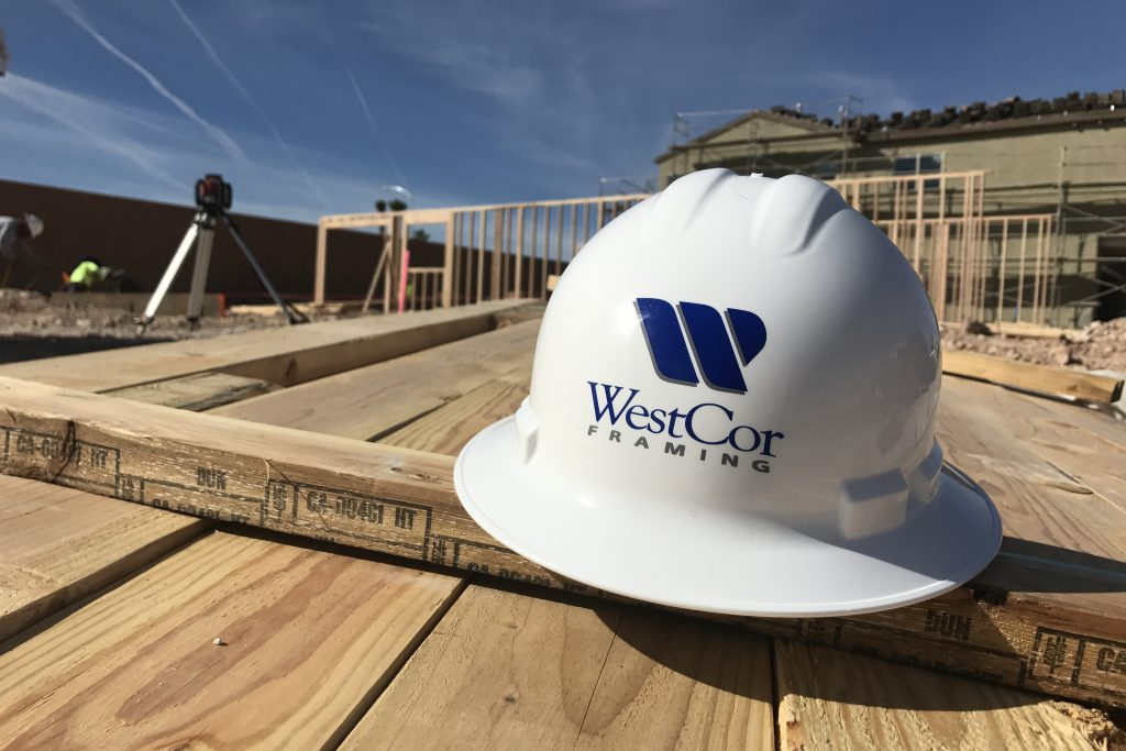 A WestCor Framing hardhat at a construction site, a division of WestCor Companies